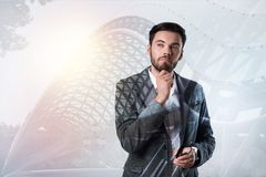 Smart elegant man looking thoughtful and interested royalty free stock images