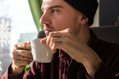 Thoughtful man with cup of coffee Royalty Free Stock Photo