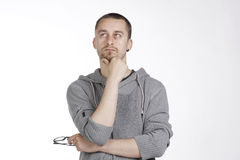 Thoughtful Man With Glasses in Hand Stock Images