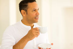 Thoughtful man having coffee Royalty Free Stock Images
