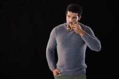 Thoughtful man having a cup of lemon tea Royalty Free Stock Photos