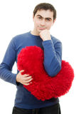 Thoughtful man holding a big red heart Royalty Free Stock Photo