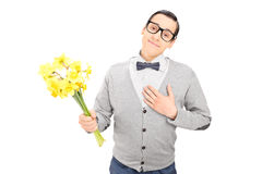 Thoughtful man holding a bunch of flowers Stock Image