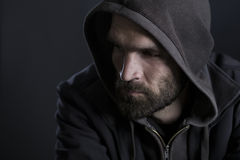 Thoughtful man with hood looking sad. Stock Photos