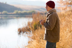 Thoughtful man lake Royalty Free Stock Images