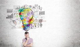 Thoughtful man with lightbulb sketch Royalty Free Stock Photography
