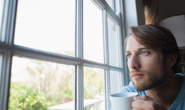 Thoughtful man looking out the window Stock Images