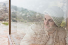 Thoughtful man looking out through window Royalty Free Stock Photography