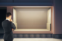 Thoughtful man looking at storefront Stock Images