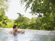 Thoughtful Man Looking At View In Pool Royalty Free Stock Images