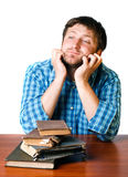 Thoughtful man near a pile of old books Royalty Free Stock Photo