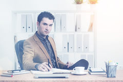 Thoughtful man at office desk Royalty Free Stock Image