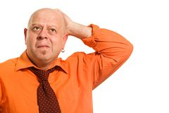 The thoughtful man in an orange shirt Royalty Free Stock Image