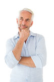 Thoughtful man posing with hand on chin Royalty Free Stock Images