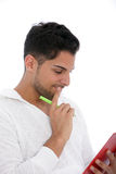 Thoughtful man reading from a clipboard Stock Photography