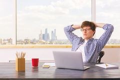 Thoughtful man relaxing in office Royalty Free Stock Photography