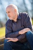 Thoughtful man sitting on a flight of steps Royalty Free Stock Photo