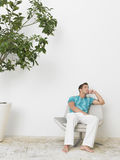 Thoughtful Man Sitting In Swivel Chair Royalty Free Stock Images