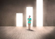Thoughtful man standing against illuminated bar graph Stock Photo