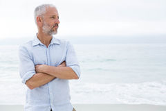 Thoughtful man standing by the sea Royalty Free Stock Photo