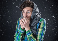 Thoughtful man standing with snow Royalty Free Stock Photo