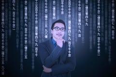 Thoughtful man translating information Royalty Free Stock Photos