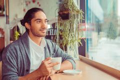Thoughtful man at trendy coffee shop looking up daydreaming royalty free stock photos