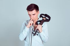 Thoughtful man with violin looking for inspiration royalty free stock photo