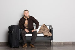 Thoughtful man in the waiting hall. Stock Photos