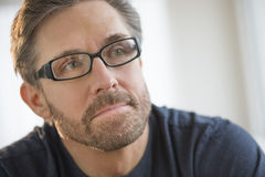Thoughtful Man Wearing Glasses Royalty Free Stock Image