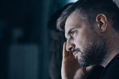Thoughtful man with withdrawal symptoms Royalty Free Stock Images
