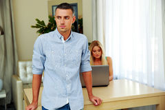 Thoughtful man with woman on background Stock Images