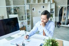Thoughtful man working in office royalty free stock photos
