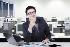 Thoughtful manager imagine something in office Stock Photo