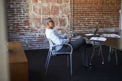 Thoughtful Mature Businessman In Boardroom Royalty Free Stock Image