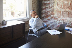 Thoughtful Mature Businessman In Boardroom Stock Images