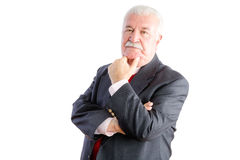 Thoughtful mature businessman in suit Stock Photos