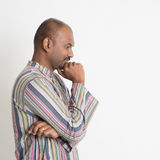 Thoughtful mature casual Indian man Stock Photography