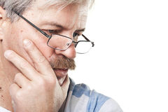 Thoughtful mature caucasian man isolated on white. Portrait of thoughtful mature caucasian man isolated on white background royalty free stock photo