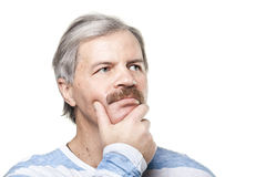 Thoughtful mature caucasian man isolated on white. Portrait of thoughtful mature caucasian man isolated on white background royalty free stock image