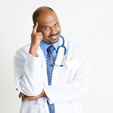 Thoughtful Mature Indian doctor Royalty Free Stock Photography