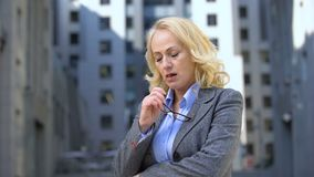 Thoughtful mature lady in business suit looking worried, work pressure, stress. Stock footage stock video footage
