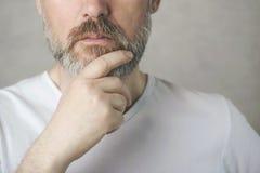 Thoughtful mature man portrait royalty free stock image