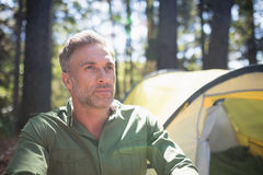 Thoughtful mature man on sunny day in forest Stock Photography