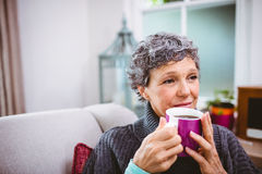 Thoughtful mature woman holding coffee cup Stock Photography