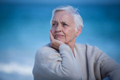 Thoughtful mature woman looking away Stock Image