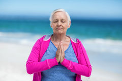 Thoughtful mature woman meditating Royalty Free Stock Photo