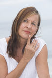 Thoughtful mature woman portrait outdoor Royalty Free Stock Photo