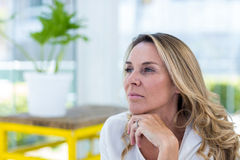 Thoughtful mature woman in restaurant Royalty Free Stock Photos