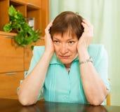 Thoughtful mature woman with sad face Stock Photos